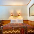 Queen Bed in Historic Lodge Room